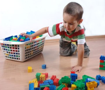 boy-putting-toys-away-1378933741