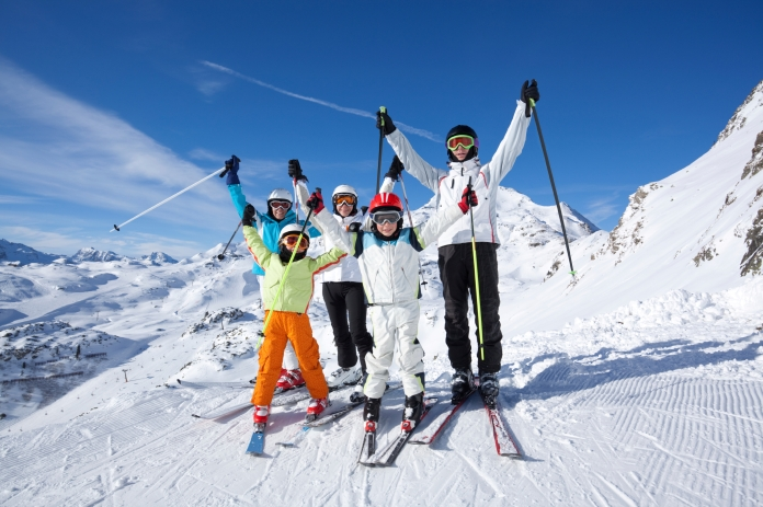 happy family on skis with wonderful winter panorama