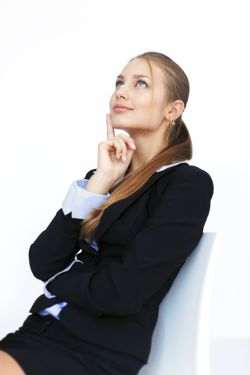 young businesswoman sitting on a chair and looking up