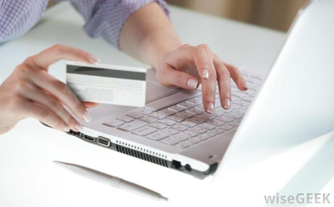 a-woman-at-computer-with-credit-card