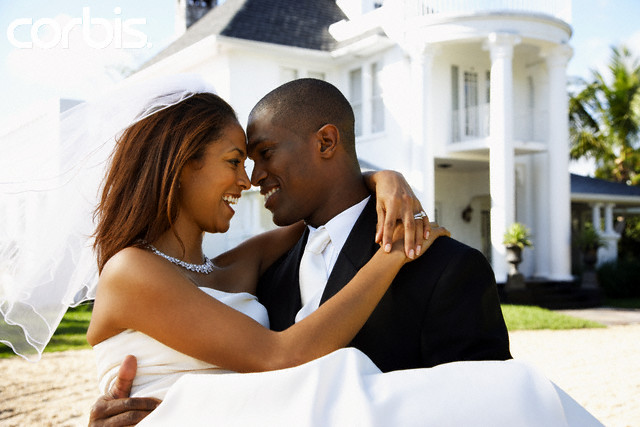Happy Newlyweds in Front of Mansion --- Image by © Greg Hinsdale/Corbis