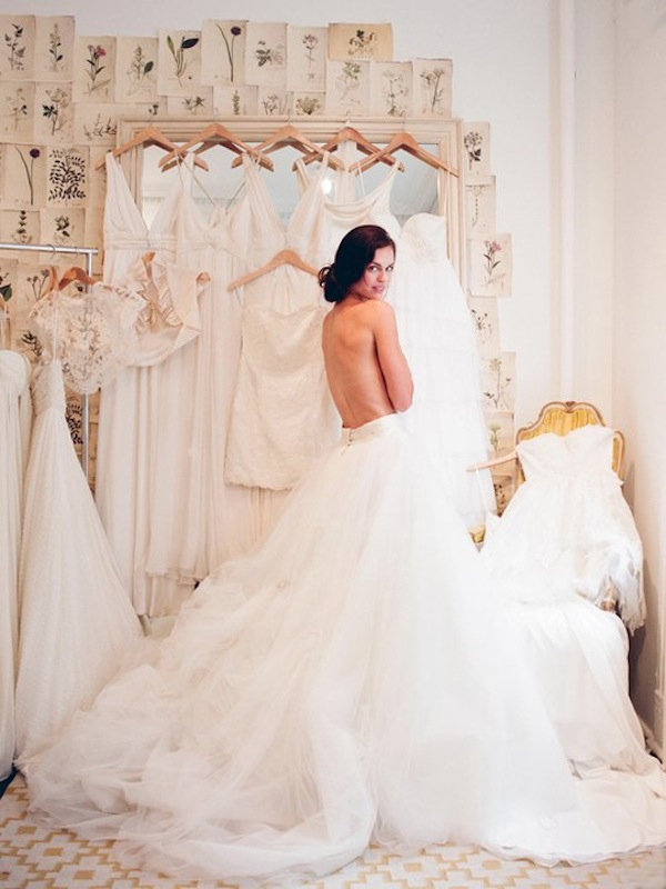 Elizabeth-Messina-bride-trying-on-wedding-dresses