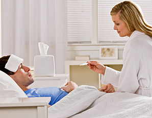 wife-taking-care-of-sick-husband-bed-temperature-298x232