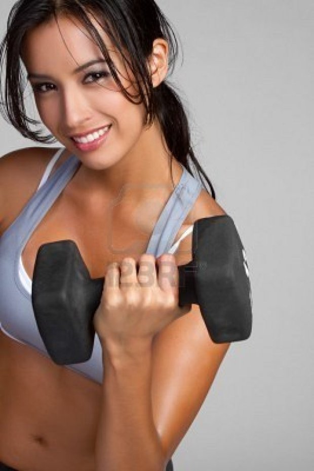 9105750-smiling-fitness-woman-lifting-weights