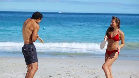 613660099-paddle-boat-boyfriend-girlfriend-bikini