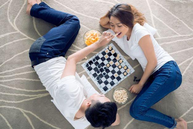 couple-lying-floor-playing-chess.jpg.838x0_q80