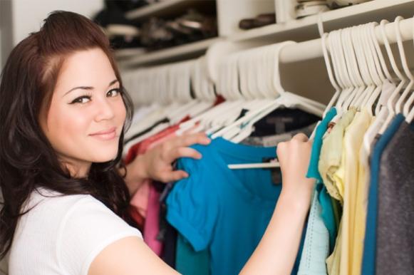 woman-organizing-her-closet