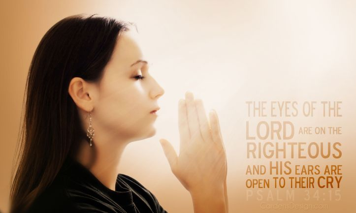 A woman praying with her hands together on white background