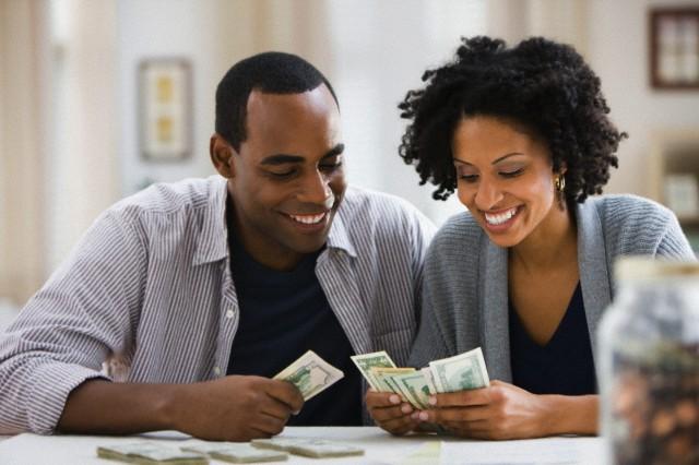 Couple counting money --- Image by © Jose Luis Pelaez Inc/Blend Image/Blend Images/Corbis