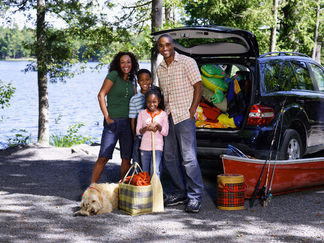 Family at Lake for Vacation --- Image by © Larry Williams/Corbis