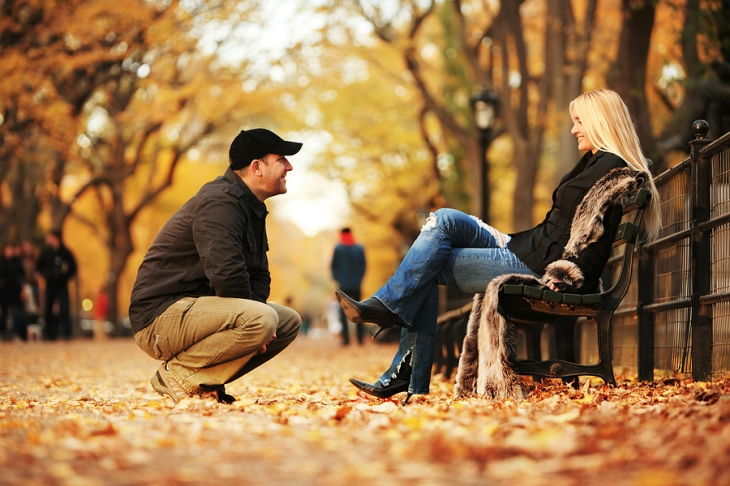 bigstock-couple-in-autumn-park-125584851