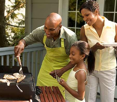 family-enjoying-summer-barbecue
