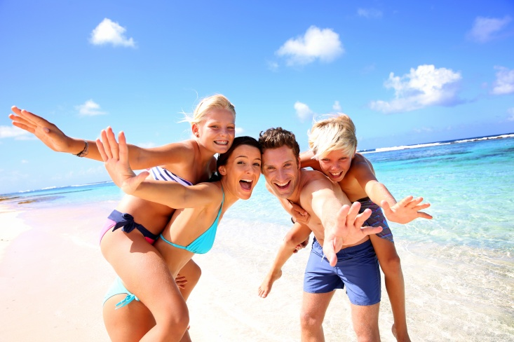 Cheerful family in the sun