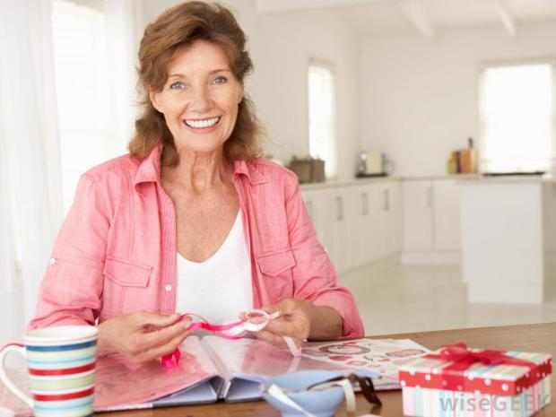 woman-in-pink-working-on-scrapbook