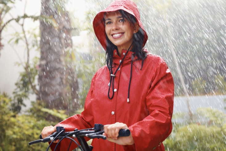 bigstock-woman-in-raincoat-going-for-bi-11599616