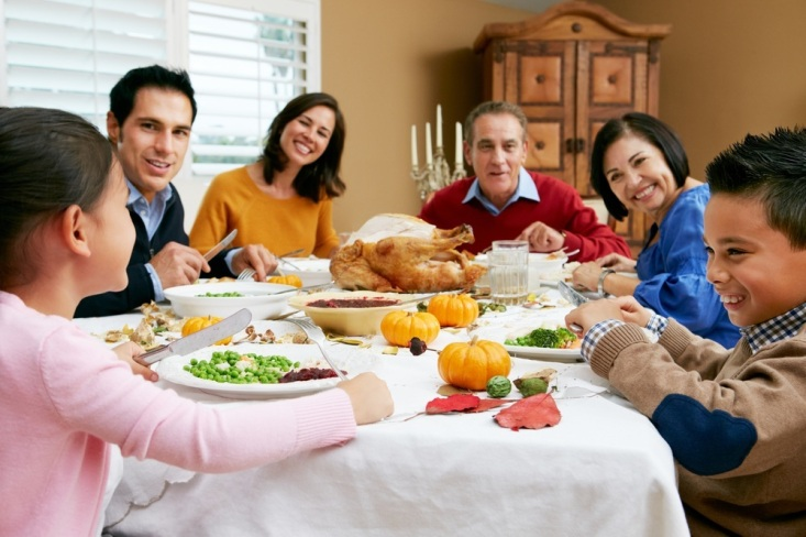 a-family-at-a-dining-room-table-eating-thanksgiving-dinner