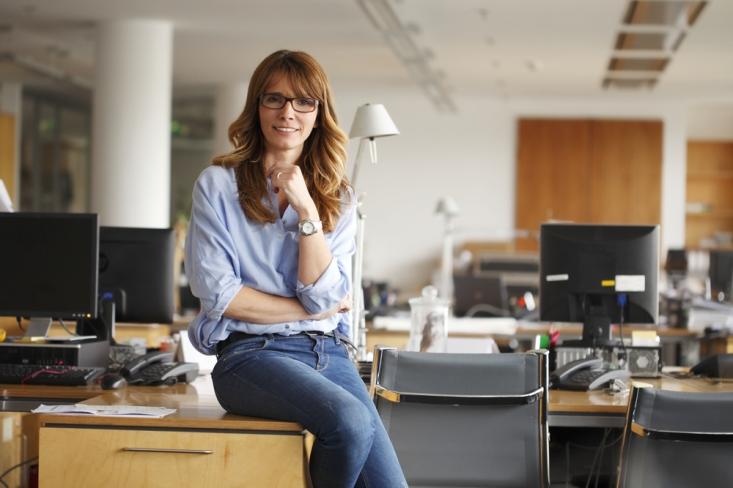 woman-ceo-sitting-on-desk