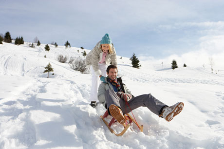 01_hooky_sledding_couple_460x306