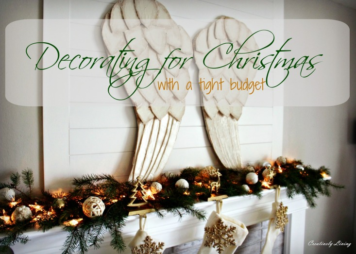 christmas-mantel-decor-with-stockings-and-star-lights-on-a-tight-budget-with-huge-awesome-beautiful-festive-angel-wings-by-creatively