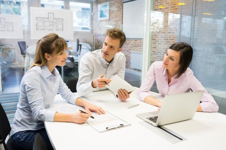 Businesswoman businessman reunion laptop desk colleagues